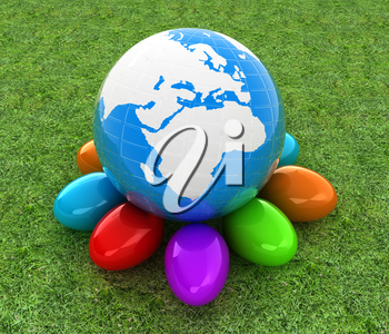 Earth on Colored Easter eggs on a green grass