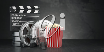 Cinema movie concept  background. Film reel and tape, popcorn and clapperboard on black grunge background. 3d illustratioon