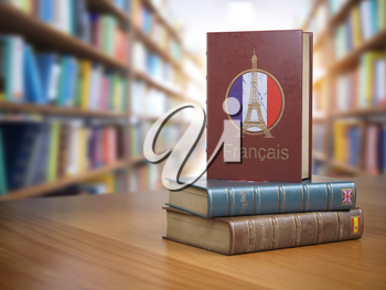 Learn French concept. French dictionary book or textbok with flag of France and Eiffel tower on the cover in the library. 3d illustration