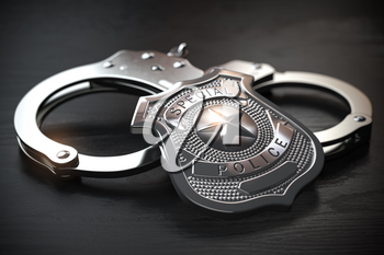 Special police badge and handcuffs ion wooden table. Law enforcement amd security. 3d illustration
