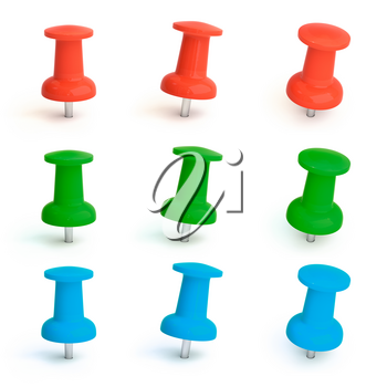Colorful pins set in green, red and blue. Isolated on white.