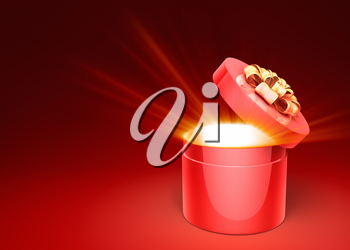 Red gift box with magical shining light