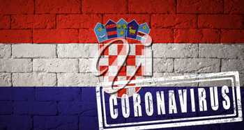 Flag of the Croatia with original proportions. stamped of Coronavirus. brick wall texture. Corona virus concept. On the verge of a COVID-19 or 2019-nCoV Pandemic.