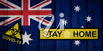 Flag of the Australia in original proportions. Quarantine and isolation - Stay at home. flag with biohazard symbol and inscription COVID-19.
