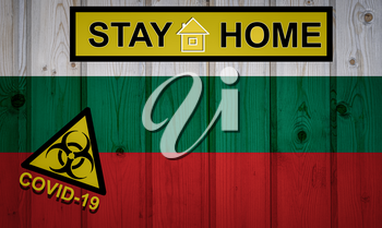 Flag of the Bulgaria in original proportions. Quarantine and isolation - Stay at home. flag with biohazard symbol and inscription COVID-19.