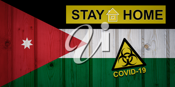 Flag of the Jordan in original proportions. Quarantine and isolation - Stay at home. flag with biohazard symbol and inscription COVID-19.