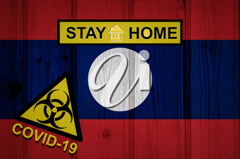 Flag of the Laos in original proportions. Quarantine and isolation - Stay at home. flag with biohazard symbol and inscription COVID-19.