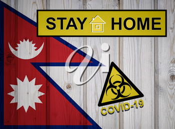 Flag of the Nepal in original proportions. Quarantine and isolation - Stay at home. flag with biohazard symbol and inscription COVID-19.