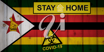 Flag of the Zimbabwe in original proportions. Quarantine and isolation - Stay at home. flag with biohazard symbol and inscription COVID-19.