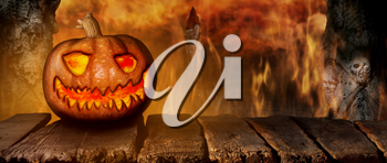 Spooky Halloween Pumpkin On a Wooden Table at Night .With Mistery Horror Background With Cemetery and Fire 3D Illustration