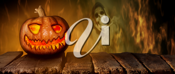 Spooky Halloween Pumpkin On a Wooden Table at Night .With Mistery Horror Background With Cemetery, Death Reaper, Smoke and Fire 3D Illustration